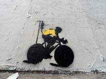 Stencil Graffiti Depicts Lance Armstrong In Yellow Jersey With IV Drip