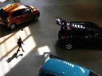 File photo of a girl running at a Toyota Motor Corp's showroom in Tokyo