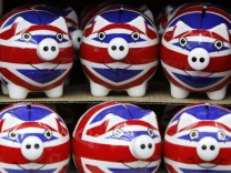 File photo of a row of piggy banks adorned with the colours of Britain's Union Jack flag displayed in a souvenir shop in London