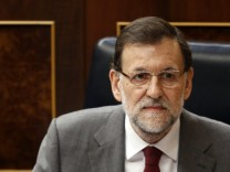 Spanish Prime Minister Mariano Rajoy is photographed in his seat at the start of a government's control session at Parliament in Madrid