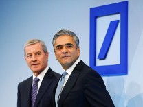 Co-Chairmen of Germany's largest business bank, Deutsche Bank, Jain and Fitschen arrive for the bank's annual news conference in Frankfurt