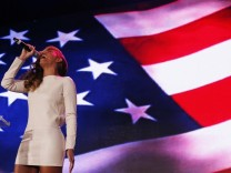 Recording artist Beyonce performs the National Anthem during the halftime show press conference ahead of the NFL's Super Bowl XLVII in New Orleans