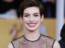 Actress Anne Hathaway arrives at the 19th annual Screen Actors Guild Awards in Los Angeles
