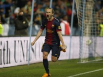Barcelona's Andres Iniesta celebrates after scoring a goal against Malaga during their Spanish King's Cup quarter-final second leg soccer match at La Rosaleda stadium in Malaga