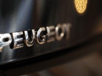 The word Peugeot is displayed on an automobile on display at a dealership in Bordeaux