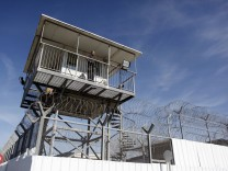 Israeli prison guard keeps watch from a tower at Ayalon prison in Ramle near Tel Aviv