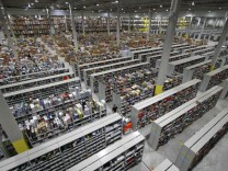 A general view shows packages at the Amazon warehouse in Leipzig