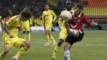 Anzhi Makhachkala's Andrei Eschenko fights for the ball with Hannover 96's Szabolcs Huszti during their Europa League soccer match at the Luzhniki stadium in Moscow
