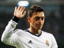 Real Madrid's Ozil gesture during Spanish first division soccer match against Rayo Vallecano at Santiago Bernabeu stadium in Madrid