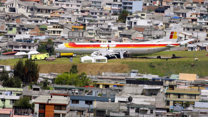 An Iberia Airlines Airbus is seen at the end of a runway at Quito's international airport