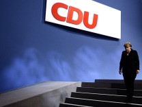 German Chancellor and leader of CDU Merkel leaves stage during party convention  in Leipzig