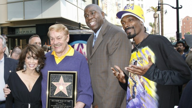 File photograph of Jerry Buss and rap artist Snapp Dogg posing on the Hollywood Walk of Fame in Hollywood