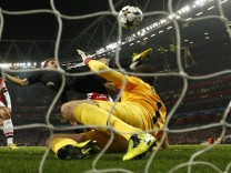 Bayern Munich's Muller scores a goal past Arsenal's Szczesny during their Champions League soccer match at the Emirates Stadium in London