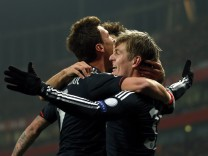 Bayern Munich's Kroos celebrates with teammates after scoring against Arsenal during their Champions League soccer match at the Emirates Stadium in London