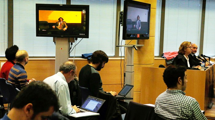 Former cyclist Tyler Hamilton of the U.S. testifies through video conference from the Spanish Embassy in Washington, during Operacion Puerto doping trial in Madrid