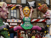 A carnival float with papier-mache depicting Russian President Putin, a member of female punk band 'Pussy Riot' and a religious man is pictured  at the traditional Rose Monday carnival parade in Duesseldorf