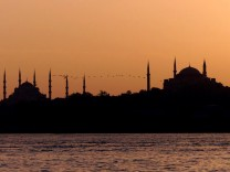 MIGRATING BIRDS FLY OVER BLUE MOSQUE AND ST SOPHIA BASILICA IN ISTANBUL