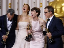 Day-Lewis, Lawrence, Hathaway and Waltz pose with their Oscars backstage at the 85th Academy Awards in Hollywood