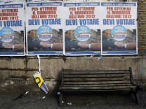 Election campaign posters of PDL (People of Freedom) member Silvio Berlusconi are seen in Rome