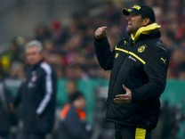 Borussia Dortmund's coach Klopp reacts during his team's German soccer cup, DFB Pokal, quarter final match against Bayern Munich in Munich