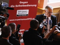 Thomas Minder, Councillor of State and initiator of the 'Against rip-off' initiative speaks to media during a voting event in Schaffhausen