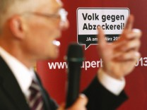 Minder, councillor of State and initiator of the 'Against rip-off' initiative speaks to media during a voting event in Schaffhausen