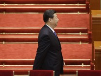 China's Communist Party Chief Xi arrives before the opening ceremony of the National People's Congress