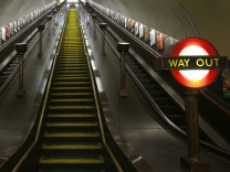 A passenger uses the escalator to the platforms at St John's Wood Underground Station, in London