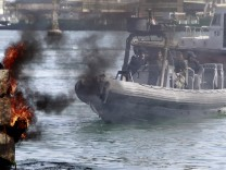 Naval units secure the area after protesters burned tyres in Port Said city