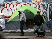 People wake up on downtown Los Angeles' Skid Row