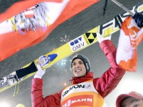 Austria's Gregor Schlierenzauer celebrates with his team members after the FIS Ski Jumping World Cup Large Hill competition in Kuopio