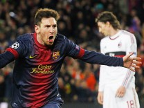Barcelona's Messi celebrates after scoring his second goal against AC Milan during their Champions League round of 16 second leg soccer match in Barcelona