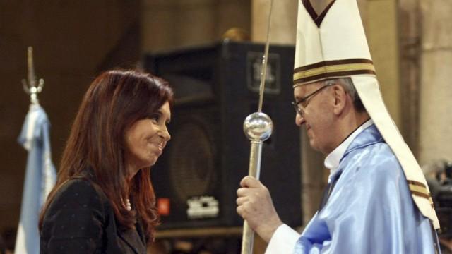 Argentine President Fernandez greets Cardinal Bergoglio at the Basilica of Lujan