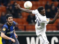 Inter Milan's Chivu and Tottenham Hotspur's Adebayor watch the ball during their Europa League soccer match in Milan