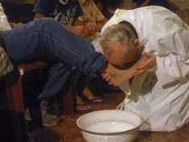 Then Cardinal Bergoglio washes and kisses the feet of patients of the Hogar de Cristo shelter for drug users, during a Holy Thursday mass in the Parque Patricios neighborhood of Buenos Aires