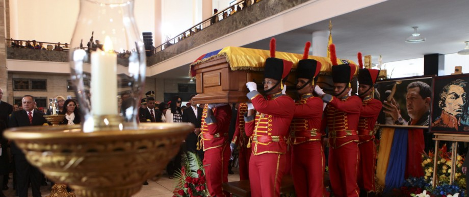 Handout photo of pallbearers carrying the coffin of Venezuela's late President Hugo Chavez to a hearse prior to a funeral parade in Caracas