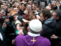 Pope Francis I greets the crowds after conducting a mass in Saint Anna church inside the Vatican