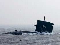 A Hai Lung diesel-electric submarine emerges from the sea during a naval demonstration off the waters of Kaohsiung, southern Taiwan