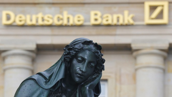A statue is pictured in front of the former head quarters of Germany's largest business bank, Deutsche Bank in Frankfurt