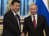 Xi Jinping macht seinen Antrittsbesuch bei Wladimir Putin in Moskau