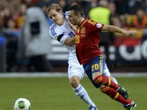 Finland's Pukki challenges Spain's Cazorla Gonzalez during their 2014 World Cup qualifying soccer match in Gijon