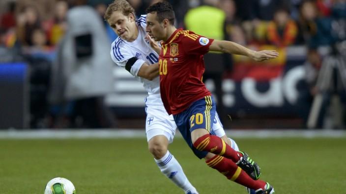 Finland's Pukki challenges Spain's Cazorla Gonzalez during their 2014 World Cup qualifying soccer match in Gijon