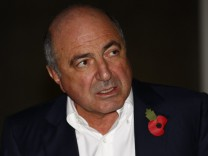 Exiled Russian tycoon Boris Berezovsky leaves a division of the High Court in central London
