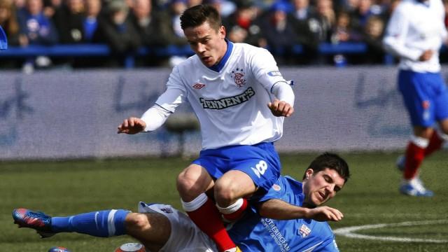 Montrose's Masson tackles Rangers' Black during their Scottish Third Division soccer match at Links Park stadium in Montrose, Scotland