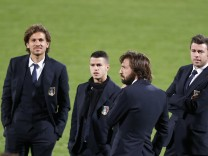 Itay's Cerci, Giovinco, Pirlo and Barzagli talk during a pitch inspection at the National Stadium in Ta'Qali, outside Valletta