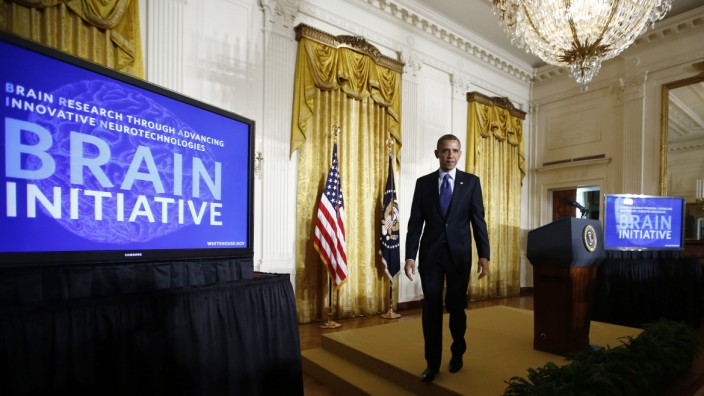 Obama walks off stage after announcing his administration's BRAIN initiative at the White House in Washington