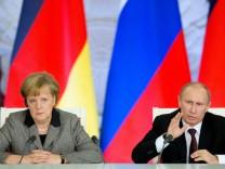 Kanzlerin Merkel und Russlands Präsident Putin