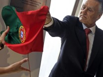 Portugal's President Anibal Cavaco Silva removes the Portuguese flag to unveil a plaque during the inauguration of GALP's new refinery plant in Sines