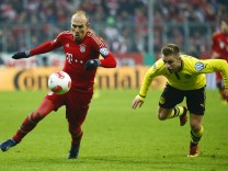 Bayern Munich's Robben is followed by Borussia Dortmund's Bender during their German soccer cup, DFB Pokal, quarter final match in Munich