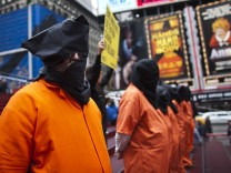 Activists dressed as prisoners demand the closure of the U.S. military's detention facility in Guantanamo Bay, Cuba while taking part in a protest in New York